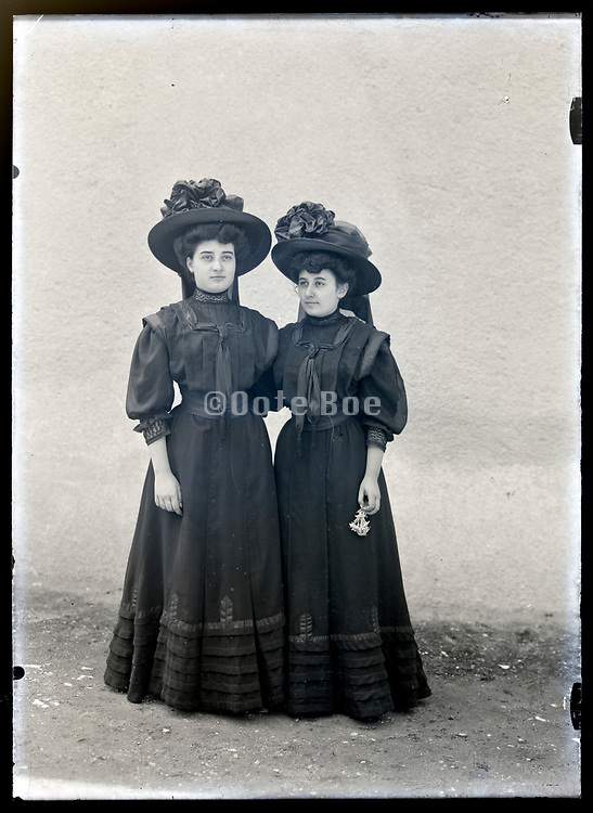 two young adult women standing outside France circa 1920s