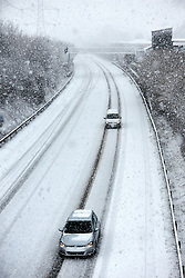 © Licensed to London News Pictures. 24/01/2021. Wendover, UK.  Cars drive down the A413 Wendover Bypass as heavy snow falls in the Chilterns. The Met office has issued a yellow warning for snow covering most of the south of England until 23:59 tonight.   Photo credit: Cliff Hide/LNP