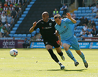 Photo: Steve Bond.<br />Coventry City v West Bromwich Albion. Coca Cola Championship. 28/04/2007. Diomansy Kamara (L) fights off the attentions od David McNamee (R)