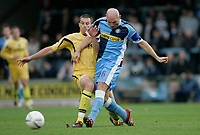 Photo: Marc Atkins.<br />Wycombe Wanderers v Oxford United. The FA Cup. 11/11/2006.<br />Tommy mooney of Wycombe in action with Chris Willmott of Oxford.