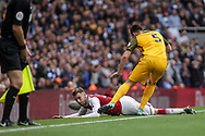 Aaron Ramsey Of Arsenal appeals for a foul after being fouled by lewis Dunk of Brighton and Hove Albion ®.<br /> Premier league match, Arsenal v Brighton & Hove Albion at the Emirates Stadium in London on Sunday 1st October 2017. pic by Kieran Clarke, Andrew Orchard sports photography.