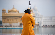 Sikh guard with lance and turban at the Golden Temple in Amritsar (India)
