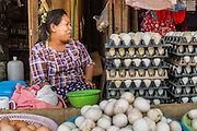 02 MARCH 2014 - MYAWADDY, KAYIN, MYANMAR (BURMA): An egg seller on a street in Myawaddy. Myawaddy is separated from the Thai border town of Mae Sot by the Moei River. Myawaddy is the most important trading point between Myanmar (Burma) and Thailand.PHOTO BY JACK KURTZ