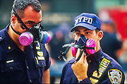 NEW YORK, NY: New York city police officers wear dust filters during their shift in lower Manhattan following the destruction of the World Trade Center towers, Sept 19, 2001. NY police shut down lower Manhattan after terrorists crashed two hijacked jetliners into the WTC collapsing the towers on Sept 11, 2001, killing more 2,900 people.   PHOTO BY JACK KURTZ