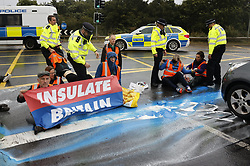 © Licensed to London News Pictures. 27/09/2021. London, UK. Insulate Britain climate activists on the M25 motorway near Heathrow airport. Climate activists have vowed to continue their campaign of disruption despite the government being granted a temporary High Court Injucntion banning the group from protesting on the M25. Photo credit: Peter Macdiarmid/LNP
