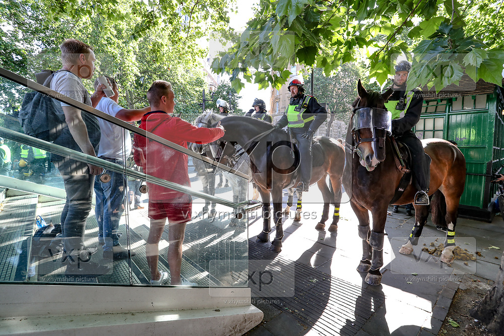 British mounted cavalry police officers try to contain members of the Far-Right Group during a protest at Embankment station, in central London, Saturday, June 13, 2020. British police have imposed strict restrictions on groups protesting in London Saturday in a bid to avoid violent clashes between protesters from the Black Lives Matter movement, as well as far-right groups that gathered to counter-protest.<br /> Anger against systemic levels of institutional racism has raged through the city, and worldwide; sparked by the death of George Floyd, who was killed in Minneapolis, US, by a policeman who restrained him with force on 25 May 2020. (Photo/ Vudi Xhymshiti)