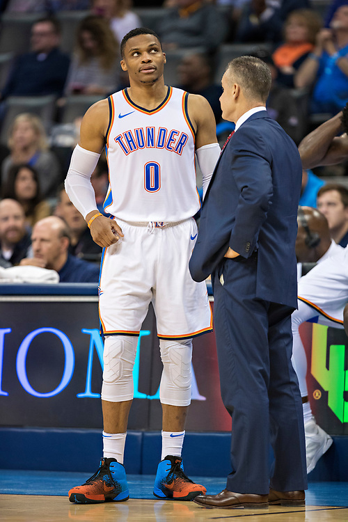 OKLAHOMA CITY, OK - OCTOBER 25:  Head Coach Billy Donovan talks with Russell Westbrook #0 of the Oklahoma City Thunder during a game against the Indiana Pacers at the Chesapeake Energy Arena on October 25, 2017 in Oklahoma City, Oklahoma.  NOTE TO USER: User expressly acknowledges and agrees that, by downloading and or using this photograph, User is consenting to the terms and conditions of the Getty Images License Agreement.  The Thunder defeated the Pacers 114-96.  (Photo by Wesley Hitt/Getty Images) *** Local Caption *** Russell Westbrook; Billy Donovan