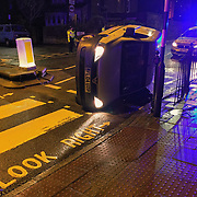 20180215-Abandoned overturned van at zebra crossing in Crouch Hill London