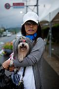 Portrait of a woman with her dog. Dajeong-ri, Jeollanam-do. South Korea, Republic of Korea, KOR, 23.05.2009.