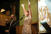 Sanderson Jones (left) and Pippa Evans (right) are cheering the people attending The Sunday Assembly (today held inside Conway Hall in central London), an atheist service founded by British comedians Sanderson Jones and Pippa Evans in 2013, in London, England. The gathering is designed to bring together non-religious people who want a similar communal experience to a religious church. Satellite assemblies have been established in over 30 cities including New York, San Diego, and Dublin.