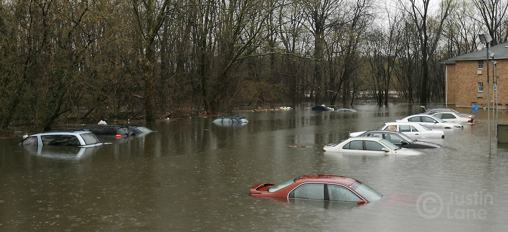 Cars sit in a flooded parking lot at a housing development in New Milford, New Jersey on Monday 16 April 2007. A large storm delivered records amount of rain to the East Coast of the United States over the weekend and today, causing New Jersey to declare a state of emergency.