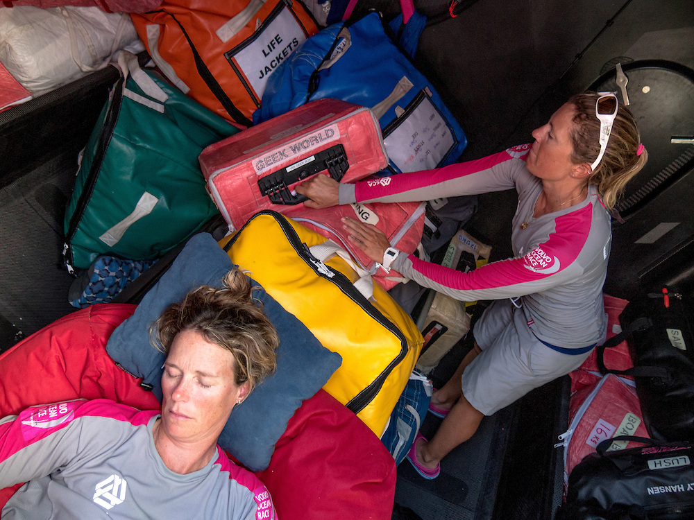 November, 2014. Leg 2 onboard Team SCA. Sam Davies stacks around a sleeping Carolijn Brouwer.