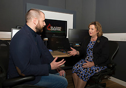 Culture Secretary Fiona Hyslop visits the studios of Blazing Griffin, a film & tv production and post production company, who have just received £200,000 GBP funding to enhance their facilities in Glasgow. She is pictured with Colin Brown of Blazing Griffin, in one of the company's purpose built editing suites.<br /> <br /> © Dave Johnston/ EEm