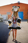 14 OCTOBER 2008  -- PHOENIX, AZ: Caroline Heston carries a leopard she won at the ring toss through the fairgrounds at the Arizona State Fair. The Arizona State Fair started Oct.  10 and runs through Nov. 2. Carnival and midway workers who have worked the fair for years say attendance so far is much lower than in the past and people at the fair this year aren't spending as much money as they have in the past. PHOTO BY JACK KURTZ