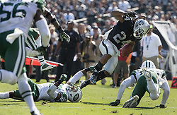 September 17, 2017 - Raiders vs. Jets.Oakland Raiders running back Marshawn Lynch (24) breaks tacklers and scores at Oakland Alameda County Stadium on Sunday, Sept. 17, 2017 in Oakland, CA (Credit Image: © Paul Kuroda via ZUMA Wire)