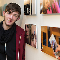 Cian Daly from Ennis who took part in the fishbowl exchange with his photographs which are on display in Scariff Library