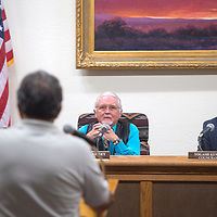 """From left,  Allan Landavazo, Mayor Jackie McKinney and Yogash Kumar listen as Sammy """"C"""" Chioda addresses the City Council Wednesday in Gallup."""