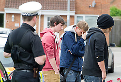 © London News Pictures. 10/06/2012.  Ampthill, UK. Emotional friends of Megan-Leigh Peat, laying flowers outside the property where 15-year-old Megan died in the early hours of Saturday morning. Schoolgirl Megan-Leigh Peat was stabbed to death at a house party thrown by a boy whose parents are away on holiday. Photo credit: Ben Cawthra/LNP