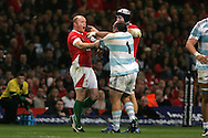 Martyn Williams of Wales is held back from an altercation with Argentinian Rodrigo Roncero by his capt Ryan Jones (r). Invesco perpetual series, Wales v Argentina at the Millennium Stadium in Cardiff on Sat 21st Nov 2009. pic by Andrew Orchard, Andrew Orchard sports photography,