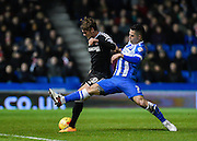 Brighton central midfielder, Beram Kayal (7) tackles Brentford midfielder John Swift during the Sky Bet Championship match between Brighton and Hove Albion and Brentford at the American Express Community Stadium, Brighton and Hove, England on 5 February 2016. Photo by David Charbit.