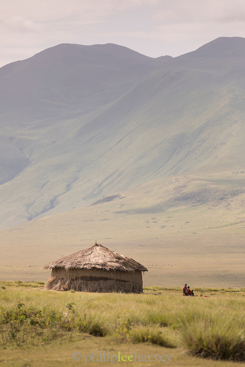 Distant view of a Masai tribe grass hut in Ngorongoro Highlands, Tanzania
