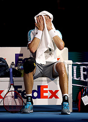 USA's John Isner towels himself down during his singles match on day four of the Nitto ATP Finals at The O2 Arena, London.