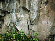 Prehistoric pictographs perhaps depicting a spiritual experience at this location along a columnar basalt cliff near the Yakima River in Central Washington, USA.