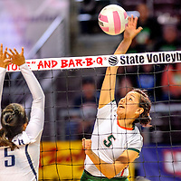 Wingate Bear Keziah Pine (5) spikes over Silver City Mustang Kim Renteria (5) during the state volleyball tournament at the Santa Ana Star Center in Rio Rancho  Friday.
