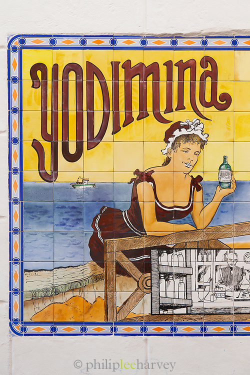 Close-up of advertisement painted on tiles, Cadiz, Andalusia, Spain
