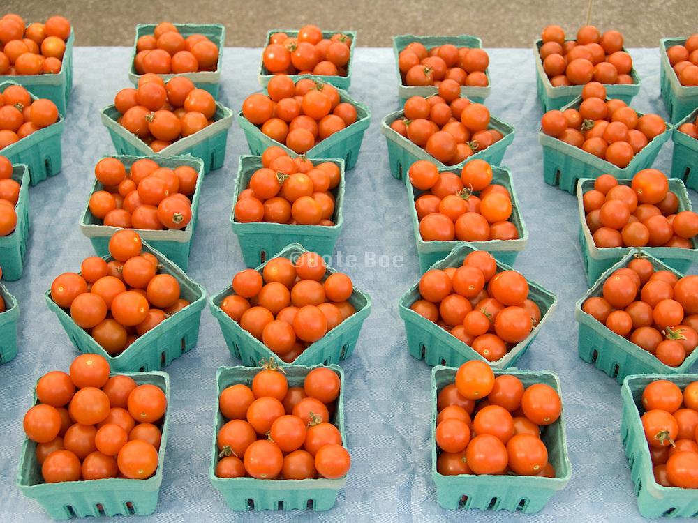 organic tomatoes decorative display at a green market.