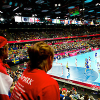 Iceland and Sweden compete in handball at the Copper Box during the 2012 London Summer Olympics.