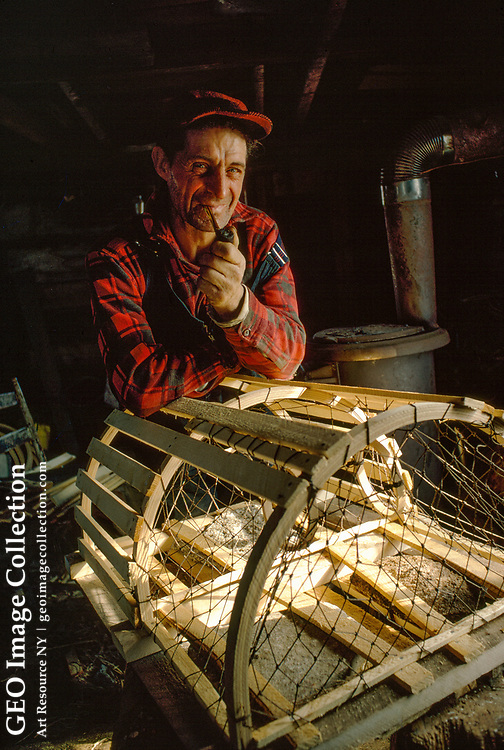 A Nova Scotian fisherman builds lobster pots for trapping his quarry.