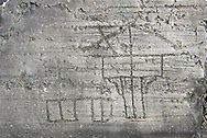 Petroglyph, rock carving, of a house on stilts. Carved by the ancient Camunni people in the iron age between 1000-1200 BC. Rock no 24, Foppi di Nadro, Riserva Naturale Incisioni Rupestri di Ceto, Cimbergo e Paspardo, Capo di Ponti, Valcamonica (Val Camonica), Lombardy plain, Italy .<br /> <br /> Visit our PREHISTORY PHOTO COLLECTIONS for more   photos  to download or buy as prints https://funkystock.photoshelter.com/gallery-collection/Prehistoric-Neolithic-Sites-Art-Artefacts-Pictures-Photos/C0000tfxw63zrUT4<br /> If you prefer to buy from our ALAMY PHOTO LIBRARY  Collection visit : https://www.alamy.com/portfolio/paul-williams-funkystock/valcamonica-rock-art.html