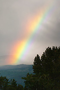 View of a rainbow over the Cimarron Ridge, between Ouray and Montrose, Colorado, USA