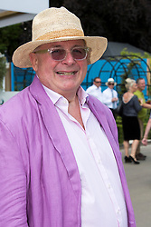 © Licensed to London News Pictures. 19/05/2014. London, England. Christopher Biggins.  Press Day at the RHS Chelsea Flower Show. On Tuesday, 20 May 2014 the flower show will open its doors to the public.  Photo credit: Bettina Strenske/LNP