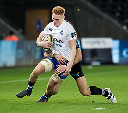 Bath Rugby's Miles Reid is tackled by Ospreys' James Hook<br /> <br /> Photographer Simon King/Replay Images<br /> <br /> Anglo-Welsh Cup Round 4 - Ospreys v Bath Rugby - Friday 2nd February 2018 - Liberty Stadium - Swansea<br /> <br /> World Copyright © Replay Images . All rights reserved. info@replayimages.co.uk - http://replayimages.co.uk
