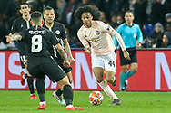Manchester United Forward Tahith Chong takes on and battles with Leandro Paredes during the Champions League Round of 16 2nd leg match between Paris Saint-Germain and Manchester United at Parc des Princes, Paris, France on 6 March 2019.