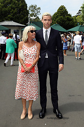 Will Poulter arrives with his mum Caroline on day two of the Wimbledon Championships at the All England Lawn Tennis and Croquet Club, Wimbledon.