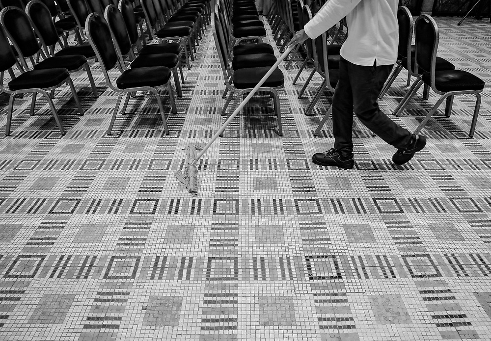 A worker cleans the floor in Jerusalem, Israel.