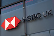 Sign for the brand and high street bank HSBC on 5th November 2020 in Birmingham, United Kingdom. HSBC Bank plc is a British multinational banking and financial services organisation. HSBC's international network comprises around 7,500 offices in over 80 countries globally.