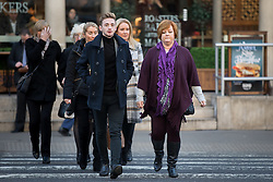 © Licensed to London News Pictures. 18/01/2017. London, UK. Terror attack survivor Owen Richards and mother Suzy Evans arriving at The Royal Courts of Justice for the third day of an inquest into the death of 30 Brits in the Tunisia terror attack. The attack took place is Sousse, Tunisia, when Seifeddine Rezgui killed 38 tourists on a beach outside Imperial Marhaba hotel. Photo credit : Tom Nicholson/LNP