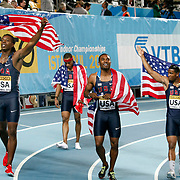 The U.S. team Gil Roberts, Manteo Mitchell, Frankie Wright and Calvin Smith hold their national flag before being disqualifyed at men's 4x400 meters relay final during the IAAF World Indoor Championships at the Atakoy Athletics Arena, Istanbul, Turkey. Photo by TURKPIX