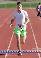 Central Valley, New York - Kieran Brown crosses the finish line in the Woodbury Country Ramble race on Aug. 26, 2012.
