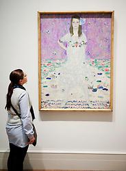 Woman looking at painting Mada Primavesi by Gustav Klimt at Metropolitan Museum of Art in Manhattan , New York City, USA