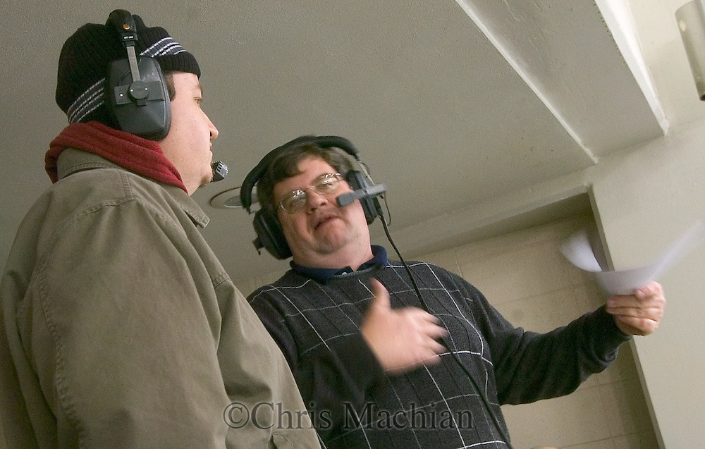 2/10/07 Omaha , IN Omaha World Herald hockey reporter CHAD PURCELL (left) is interviewed by radio announcer Terry Leahy between periods of the University of Nebraska at Omaha and  University of Notre Dame hockey game at the Joyce Center.(Chris Machian/Prairie Pixel Group)..