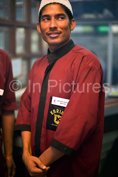 Waiter Sageer Ahmed at Karim's Restaurant, Delhi, India<br /> Karim's is a Delhi landmark was started by Haji Karimuddin who decided to open a restuarant catering to people coming to Delhi for the Coronation Durbar in 1911