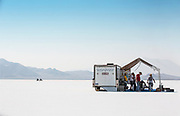 Image of a hot rod racecar prepping to race at the Bonneville Salt Flats with motorcycles in the distance, Utah, American Southwest by Randy Wells