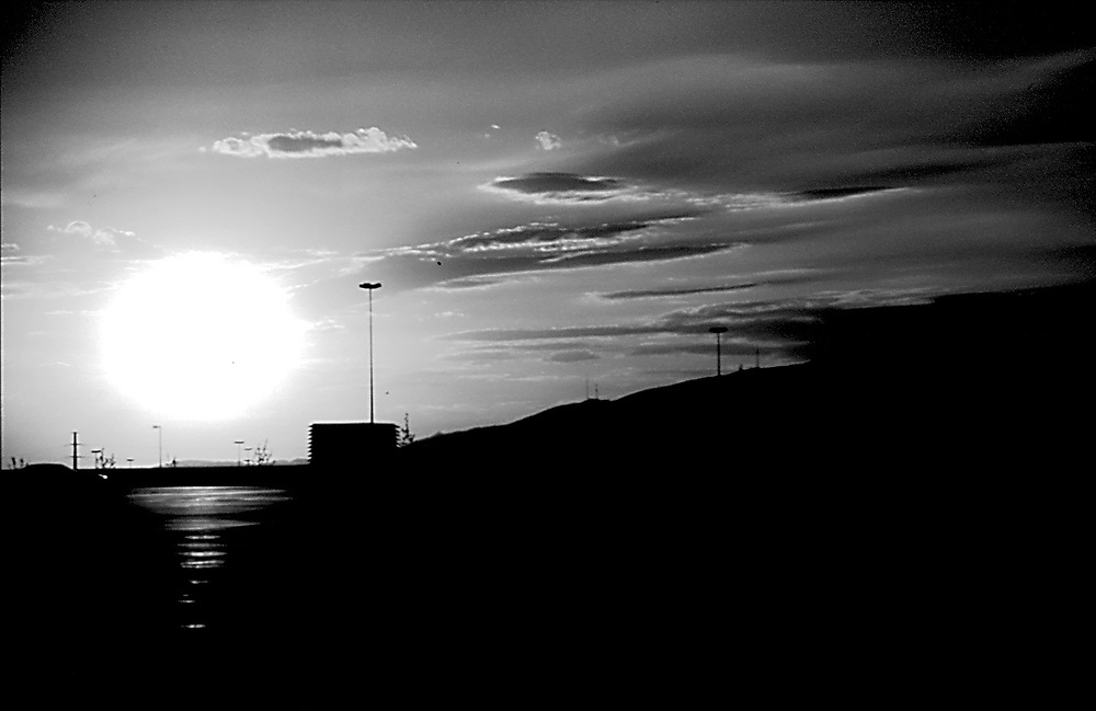 Black and white sunset silhouette , abstract .