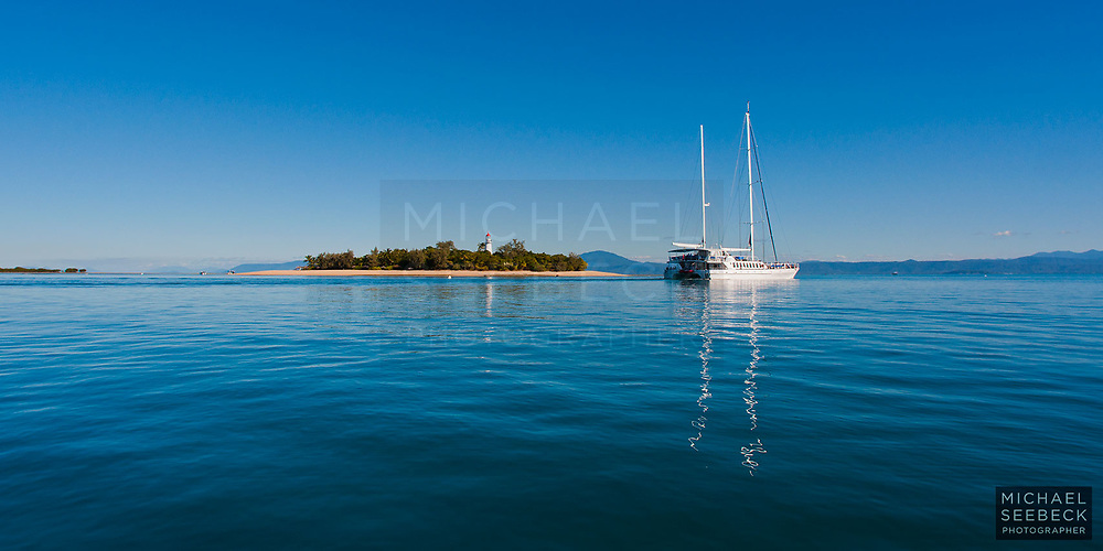 Quicksilver leaving Low Isles, mid-afternoon.<br /> <br /> Open Edition Print / Stock Image