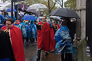 Dignitaries walk through rain showers after the Lord Mayor's Show in the City of London, the capital's ancient financial district founded by the Romans in the 1st Century. This is the pageant's 800th birthday and the 250 year-old horse-drawn guided State Coach will be pulled through the medieval streets with the newly-elected Mayor along with 7,000 others. This first took place in 1215 making it the oldest and longest civil procession in the world which survived both Bubonic plague and the Blitz.